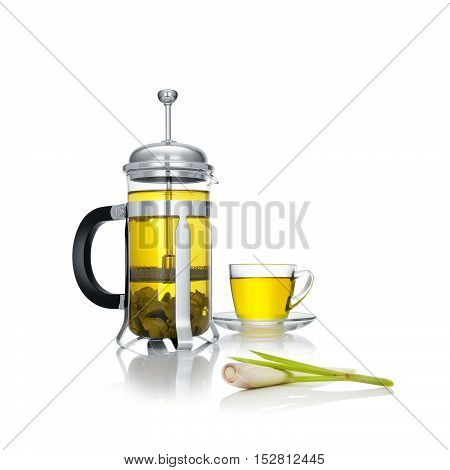 close up view of french press and a cup of green tea wuth lemongrass on white background