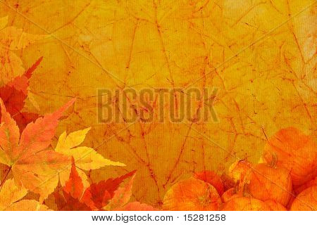 Vintage canvas background with autumn maple leaves and pumpkins.