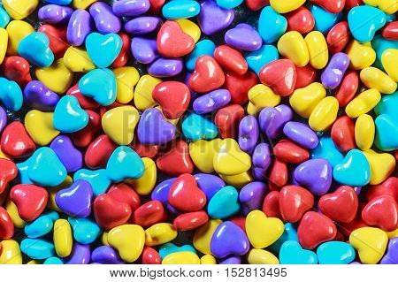 background of colored candy in heart shape