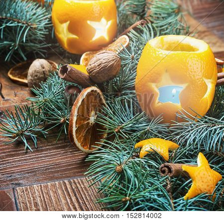 dried oranges with nuts and fir branches on the floor. Christmas decorations.