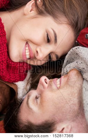 love, relationship, family and people concept - close up of happy smiling young couple faces