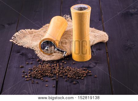 Black pepper corns and Black pepper Powder on wooden background