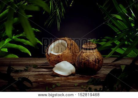 Close up view of nice fresh coconut on green leaf background