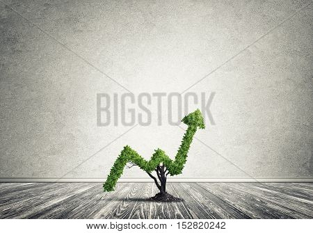 Market growth and success as growing green tree in shape of arrow