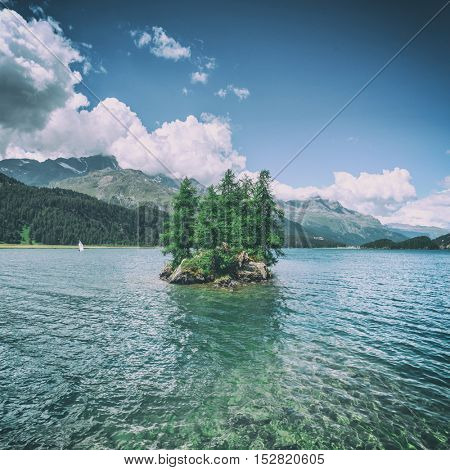 Amazing sunny day at Silsersee lake in the Swiss Alps. Segl, Switzerland, Europe, toned like Instagram filter