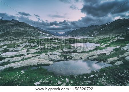 Amazing view of Totensee lake on the top of Grimselpass. Alps, Switzerland, Europe, toned like Instagram filter