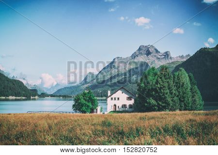 Amazing sunny day at Champferersee lake in the Swiss Alps. Silvaplana village, Switzerland, Europe, toned like Instagram filter