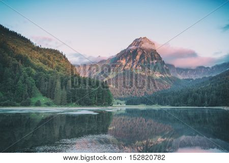 Amazing summer morning on the fantastic Swiss lake Obersee, located near Nafels village. Alps, Switzerland, Europe, toned like Instagram filter