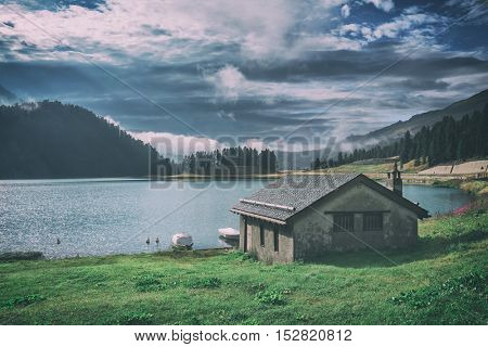 Amazing sunny morning at Champferersee lake in the Swiss Alps. Silvaplana village, Switzerland, Europe, toned like Instagram filter