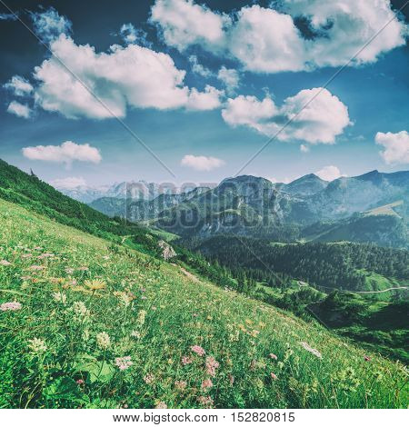Beautiful view from top of cableway above the Konigsee lake on Schneibstein mountain ridge. Border of German and Austrian Alps, Europe, toned like Instagram filter