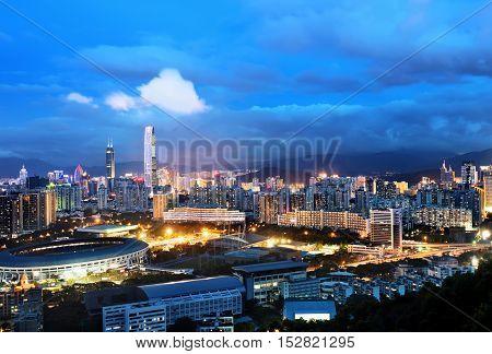 Modern skyscrapers at night in Shenzhen, China.