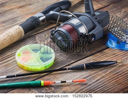 fishing tackle on a wooden table decisions, equipment