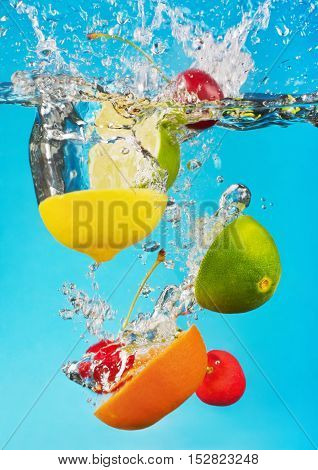 fruits fall deeply under water with a big splash