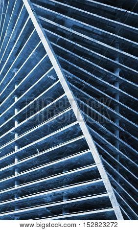 futuristic exterior of a building under construction with blue toned
