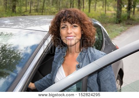 Young Traveller Woman Enjoying Standing Outside Car.