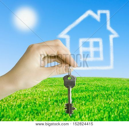hand holds the keys to the future home