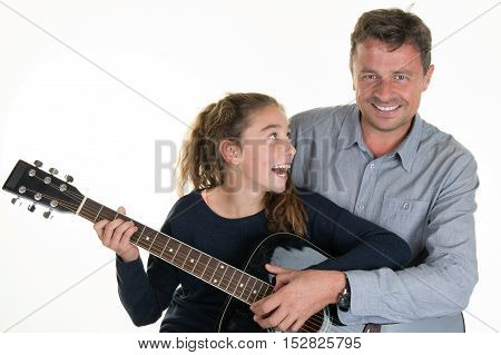 Lovely Young Girl Getting Guitar Lessons With Man