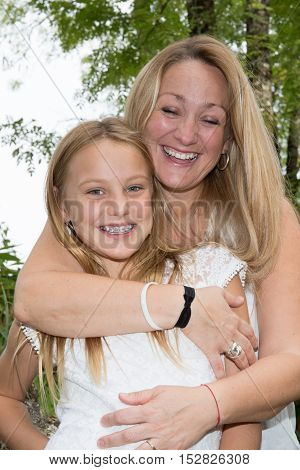 Bright Picture Of A Hugging Mother And Daughter