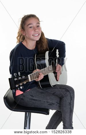 Young Caucasian Girl With Acoustic Guitar, Isolated On White Background