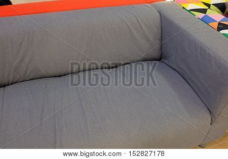 Gray Modern Cozy Sofa Display in Furniture Store Showroom.