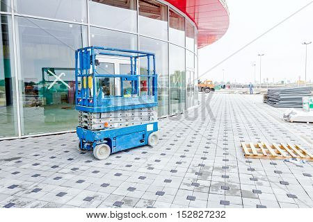 Scissor lift platform parked on a construction site after job is done.