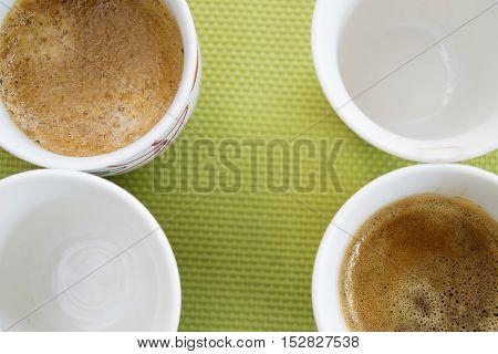 short and creamy italian coffee espresso on green background