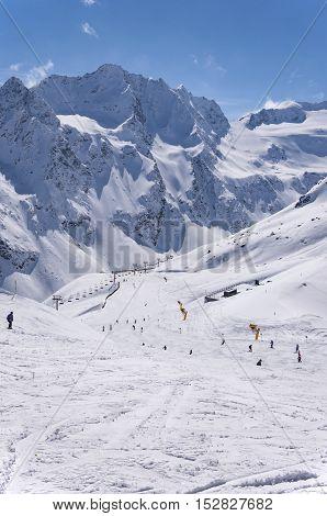 Ski lifts skiers and pistes to Rettenbach Glacier in Solden ski resort in Otztal Alps in Tirol Austria