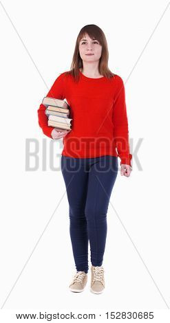 Girl comes with  stack of books. front view.   Isolated over white background. Smiling is a girl in a red jacket