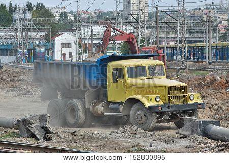 Simferopol Ukraine - September 13 2010: Old dump KrAZ-256 on the construction site being loaded