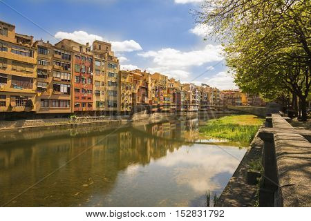 Colorful houses reflected on the river in Girona, Spain
