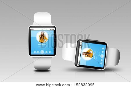 modern technology, object, responsive design and media concept - smart watches with music player application on screen over gray background
