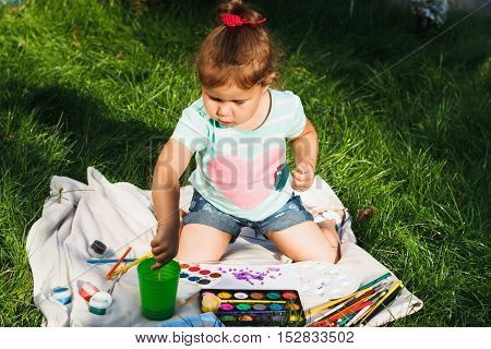 Small Girl Holds A Palette Of Watercolor