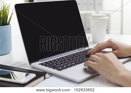 Laptop Screen With Woman's Hands On Keyboard