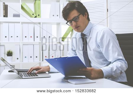 Office Employee Entering Data Into The System