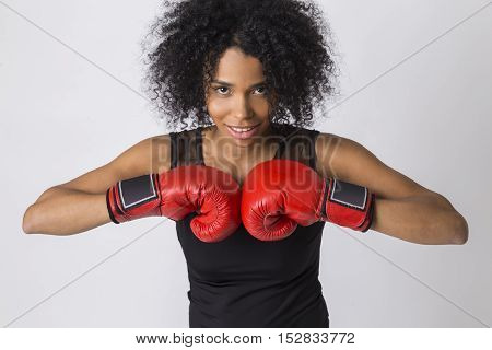African Girl With Boxing Gloves Near Chest