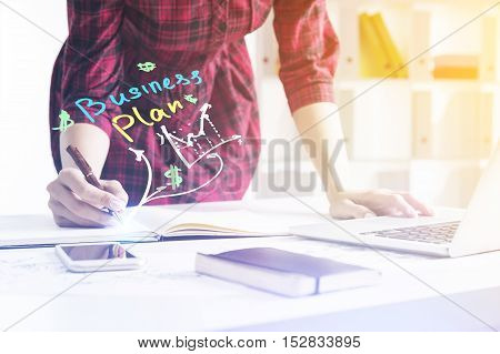 Girl Is Working On Her Business Plan In Office