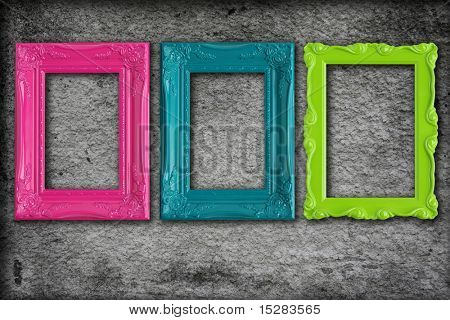 Colorful modern picture frames on a grey textured background.
