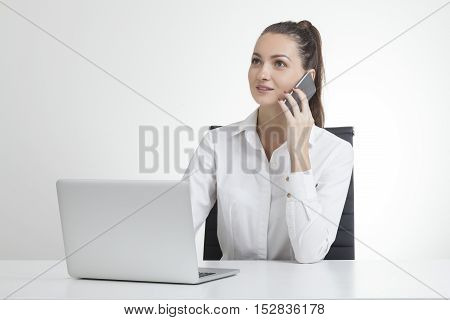 Girl With Ponytail And Her Cell Phone
