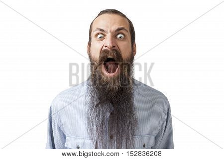 Isolated portrait of angry mad young man with long beard shouting. Concept of fundamentalism and anger management. Mock up