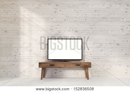 Computer monitor with wide screen is standing on narrow dark wood table in room with wooden walls. Concept of ads. 3d rendering. Mock up