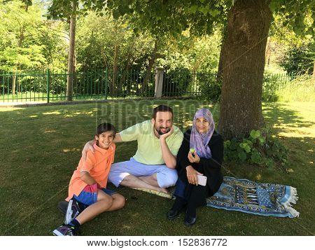 Muslim family in park