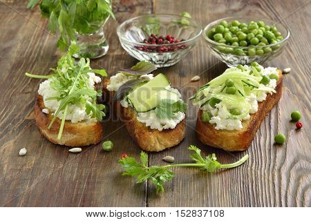 Crostini with cream cheese green vegetables and herbs