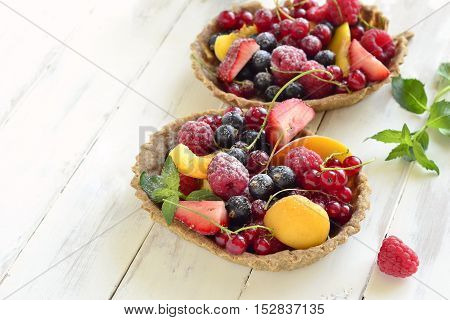 Mini Tart with fresh berries and mint, copy space