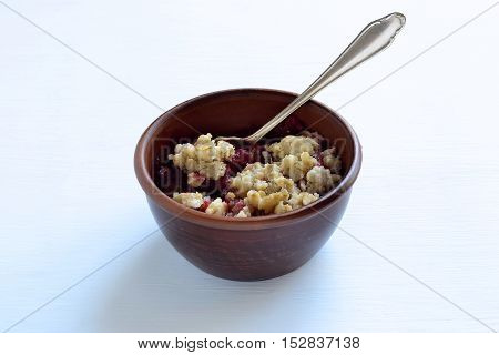 Delicious strawberry and oatmeal crumble on a blue background
