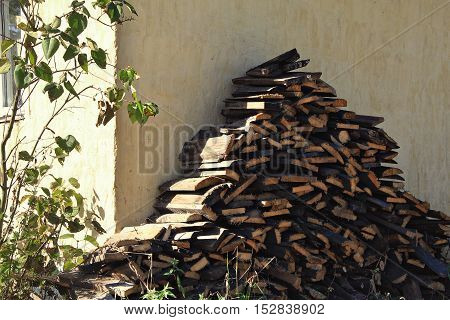 the walls are made timber chopped wood of the slab in the village for furnace countryside