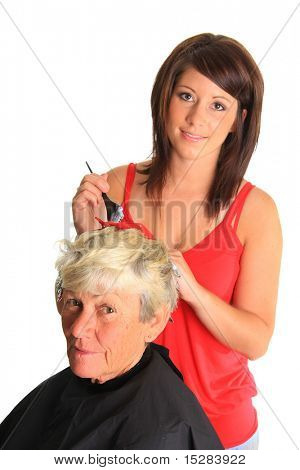 Young hairstylist putting highlights in a customers hair.