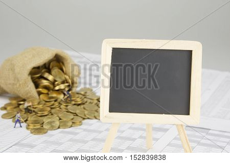 Blackboard Have Blur Coins Overflow From Sack With Construction Worker