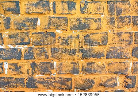 Grunge stonewall background and alternative construction material - Orange textured stone wall on modern retro fashion design - Vintage old-fashioned backdrop pattern