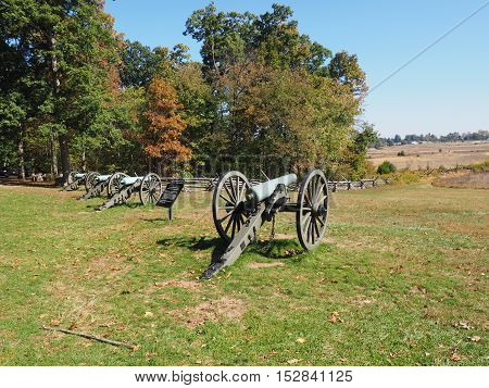 row of old cannons on the battlefield in Gettysburg Pennsylvania