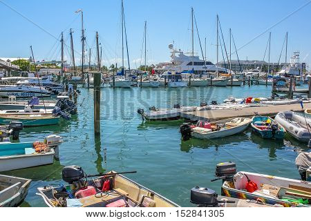 Key West, Florida, United States - April 12, 2012: motor and sailing boats docked at Harbor of Key West in Florida in a sunny day.